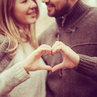 loving couple showing heart for valentine day on cozy walk